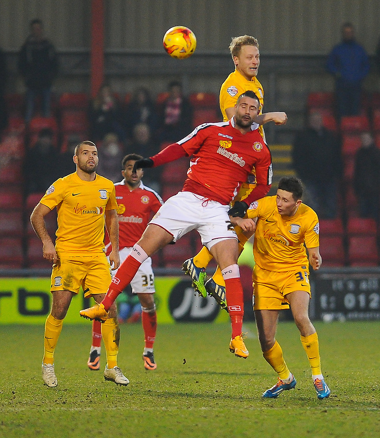 Preston North End's Tom Clarke wins the aerial battle with Crewe Alexandra's Marcus Haber<br /> <br /> Photographer Craig Thomas/CameraSport<br /> <br /> Football - The Football League Sky Bet League One - Crewe Alexandra v Preston North End - Sunday 28th December 2014 - Alexandra Stadium - Crewe<br /> <br /> &copy; CameraSport - 43 Linden Ave. Countesthorpe. Leicester. England. LE8 5PG - Tel: +44 (0) 116 277 4147 - admin@camerasport.com - www.camerasport.com
