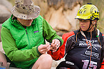 Sage Donnelly, gets her blood sugar checked by her dad Matt between rides at the Reno Riverfestival 2014. Sage is Diabetic and must constantly manage her blood sugar levels.