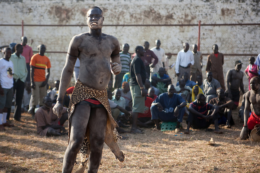 18 december 2010 - Juba, Southern Sudan - A member of the Mundari tribe from Central Equatoria State before the final of South Sudan's first commercial wrestling league between his tribe and the Dinka wrestlers from Bor, Jonglei State at Juba Stadium. The matches attracted large numbers of spectators who sang, played drums and danced in support of their favorite wrestlers. The match organizers hoped that the traditional sport would bring together South Sudan's many different tribes. Photo credit: Benedicte Desrus