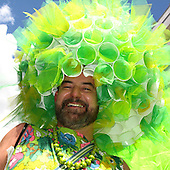 Participant with a fluorescent green hat at London Pride 2008, the gay / lesbian / gender parade in London.