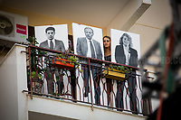 Balcony of Borsellino's Family: Paolo Borsellino, Agostino Catalano, Emanuela Loi, Vincenzo Li Muli, Walter Eddie Cosina and Claudio Traina, finally arrived at home...<br /> <br /> Palermo (Sicily - Italy), 19/07/2017. &quot;Basta depistaggi e omert&agrave; di Stato!&quot; (&quot;Stop disinformation &amp; omert&aacute; by the State!&quot;)(1). Public event to commemorate the 25th Anniversary of the assassination of the anti-mafia Magistrate Paolo Borsellino along with five of his police &ldquo;scorta&rdquo; (Escorts from the special branch of the Italian police force who protect Judges): Agostino Catalano, Emanuela Loi (The first Italian female member of the police special branch and the first woman of this branch to be killed on duty), Vincenzo Li Muli, Walter Eddie Cosina and Claudio Traina. The event was held at Via D'Amelio, the road where Borsellino was killed. Family members of mafia victims, amongst others, made speeches about their dramatic experiences, mafia violence and unpunished crimes, State cover-ups, silence ('omert&aacute;'), and misinformation. Speakers included, amongst others, Vincenzo Agostino &amp; Augusta Schiera, Salvatore &amp; Cristina Catalano, Graziella Accetta, Massimo Sole, Paola Caccia, Luciano Traina, Angela Manca, Stefano Mormile, Ferdinando Imposimato, Judge Nino Di Matteo. The event ended with the screening of the RAI docu-fiction, 'Adesso Tocca A Me' ('Now it's My Turn' - Watch it here: http://bit.ly/2w3WJUX ).<br /> <br /> For more info &amp; a video of the event please click here: http://bit.ly/2eQfNT3 &amp; http://bit.ly/2eQbmrj &amp; http://19luglio1992.com &amp; http://bit.ly/2he8hCj<br /> <br /> (1) 'Omerta' is the term used in Italy to refer to the code of silence used by mafia organisations, as well as the culture of silence that is entrenched in society at large (especially among victims of mafia crimes, as they fear recriminations), about the existence of organised crime and its activities.