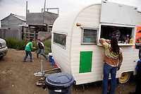 A small converted camping trailer serves as a concession stand at the Mechanical Bull-A-Rama at the Whoa Arena in Valier, Montana, USA.  The event, organized by Janelle Nelson, was a benefit for local youth rodeo participants and the local food bank.