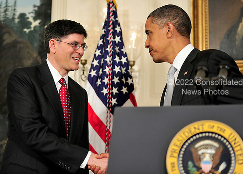 """United States President Barack Obama, right, shakes hands with Jacob J. """"Jack"""" Lew, left, after announcing he has named Lew to serve as Director of the Office of Management and Budget (OMB) in the Diplomatic Reception Room of the White House in Washington, D.C. on Tuesday, July 13, 2010..Credit: Ron Sachs - Pool via CNP"""