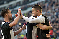 2nd February 2020; Allianz Stadium, Turin, Italy; Serie A Football, Juventus versus Fiorentina; Cristiano Ronaldo of Juventus celebrates with team mates after scoring thepenalty for 2-0 in the 80th minute