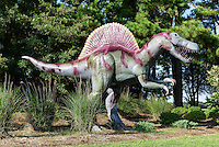 Jerrassic Park collection of dinosaur sculptures at the entrance to the Virginia Beach Airport and museum property, Virginia Beach, USA