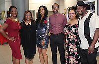 NWA Democrat-Gazette/CARIN SCHOPPMEYER Karey Gallashaw (from left); Sandra Moore; LaShaunte'a Moore, 2019 UA Sports Hall of Honor inductee; Samantha Edwards; and Terry Edwards gather at the annual event Sept. 13 at the Fayetteville Town Center.