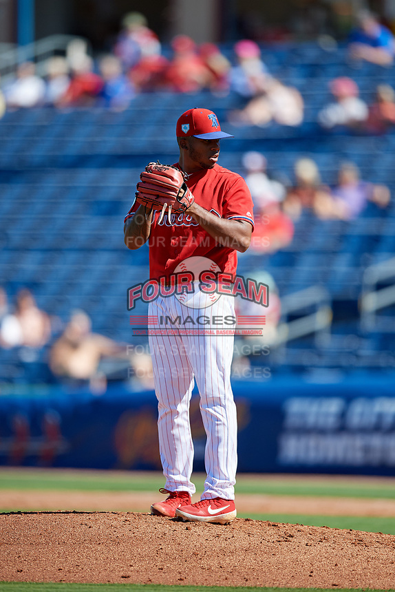 Philadelphia Phillies relief pitcher Edubray Ramos (61) gets ready to deliver a pitch during a Grapefruit League Spring Training game against the Baltimore Orioles on February 28, 2019 at Spectrum Field in Clearwater, Florida.  Orioles tied the Phillies 5-5.  (Mike Janes/Four Seam Images)