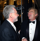 Wolf Blitzer and Jerry Springer share a laugh as they depart  the  party  hosted by Bloomberg News following the 2003 White House Correspondents Dinner in Washington, D.C. on April 26, 2003..Credit: Ron Sachs / CNP