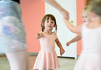 "NWA Democrat-Gazette/CHARLIE KAIJO Medow Frydrychowski, 3, (center) participates in a dance exercise during a ballet summer mini-camp, Monday, July 8, 2019 at Radiance Ballet studio in Centerton. <br /> <br /> The studio is holding a three day summer mini-camp this week for three and four year olds. The class introduces youth to the foundations of ballet, and for many students, it's their first time. The class teaches them how their body's move and ways to use their imagination.<br /> <br /> ""[Ballet is] great for sensory input, coordination, balance and focus,"" said Tara Klamm, the studio's director. ""A lot of them it's the first time they've been in a structured class environment."""