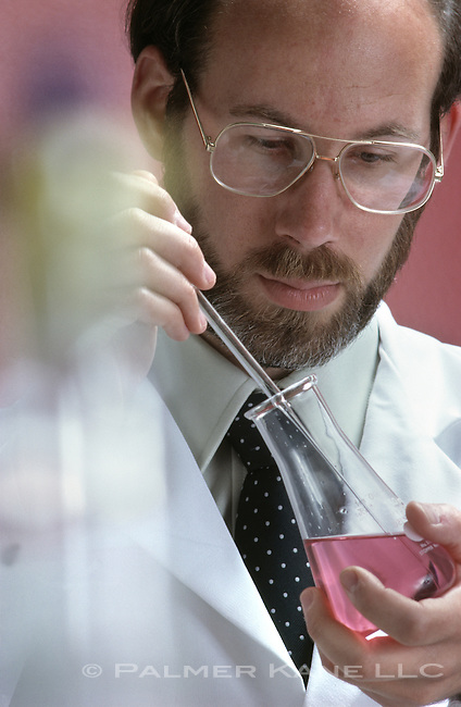 Scientist in lab with test sample