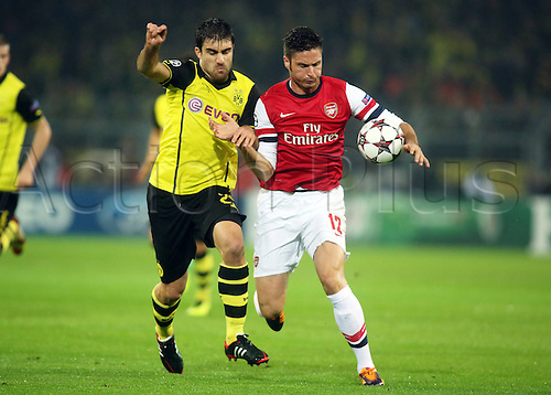 06.11.2013, Dortmund, Germany.  Sokratis Papastathopoulos against Olivier Giroud during the Champions League group F game between Borussia Dortmund and Arsenal from the Signal Iduna Park stadium.
