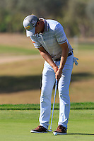 Marcel Siem (GER) putts on the 9th green during Thursday's Round 1 of the 2016 Portugal Masters held at the Oceanico Victoria Golf Course, Vilamoura, Algarve, Portugal. 19th October 2016.<br /> Picture: Eoin Clarke   Golffile<br /> <br /> <br /> All photos usage must carry mandatory copyright credit (© Golffile   Eoin Clarke)
