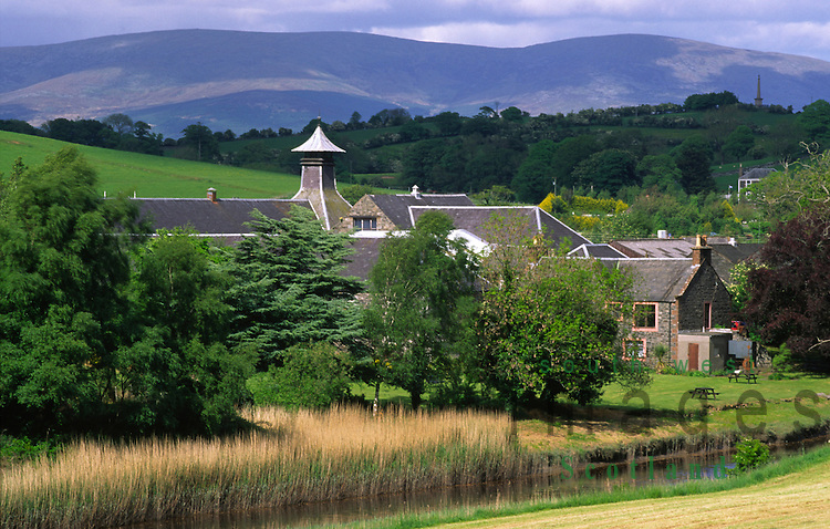 Scotlands most southerly whisky distillery Bladnoch Whisky Distillery on the River Bladnoch with Cairnsmore of Fleet behind near Wigtown Galloway Scotland UK