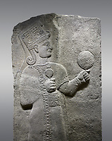 Picture &amp; image of Hittite relief sculpted orthostat stone panel of Long Wall Basalt, Karkamıs, (Kargamıs), Carchemish (Karkemish), 900 - 700 B.C. Anatolian Civilizations Museum, Ankara, Turkey.<br /> <br /> Goddess Kubaba. Goddess is depicted from the profile. The part below the chest of the relief is broken. She holds a pomegranate in her hands on her chest. She carries a one-horned headdress on her head. Her braided hair hangs down to her shoulder. The text in the hieroglyphics is not understood. The lower part of the relief has been restored. <br /> <br /> On a gray background.