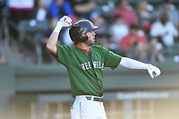 Designated hitter C.J. Chatham (10) of the Greenville Drive waves his fist and shouts after crossing the plate with the first run in a game against the Charleston RiverDogs on Sunday, April 29, 2018, at Fluor Field at the West End in Greenville, South Carolina. Greenville went on to win 2-0. (Tom Priddy/Four Seam Images)