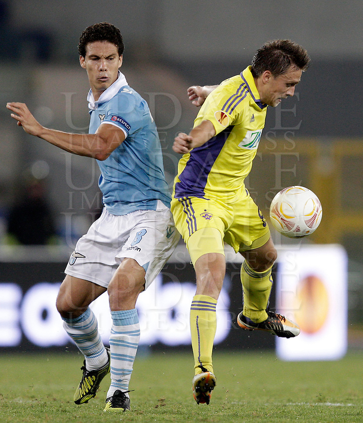 Calcio, Europa League, primo turno Gruppo J: Lazio vs Maribor. Roma, stadio Olimpico, 4 ottobre 2012..Maribor midfielder Dejan Mezga, of Croatia, right, is challenged by Lazio midfielder Hernanes, of Brazil, during the Europa League first round Group J football match between Lazio and Maribor at Rome's Olympic stadium, 4 october 2012..UPDATE IMAGES PRESS/Riccardo De Luca