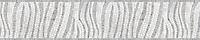 "8"" Dune border, a hand-chopped stone mosaic, shown in tumbled Carrara and Thassos."