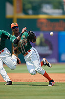Greensboro Grasshoppers shortstop Marcos Rivera (11) throws to first base during a game against the Lakewood BlueClaws on June 10, 2018 at First National Bank Field in Greensboro, North Carolina.  Lakewood defeated Greensboro 2-0.  (Mike Janes/Four Seam Images)