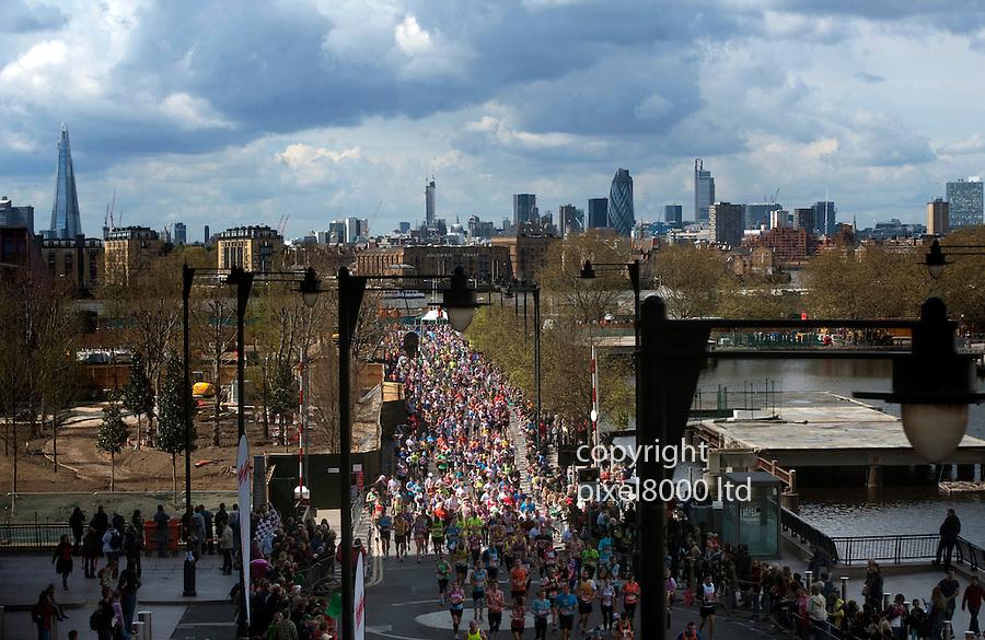London Marathon 2012.London skyline including The Shard and the Gerkhin building..Marathon runners go along near Canary Wharf.....Pic by Gavin Rodgers/Pixel 8000 Ltd
