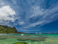 Kauai, Hawaii: Makana peak and high clouds, from the turquoise, green waters off Tunnels beach at Ha'ena