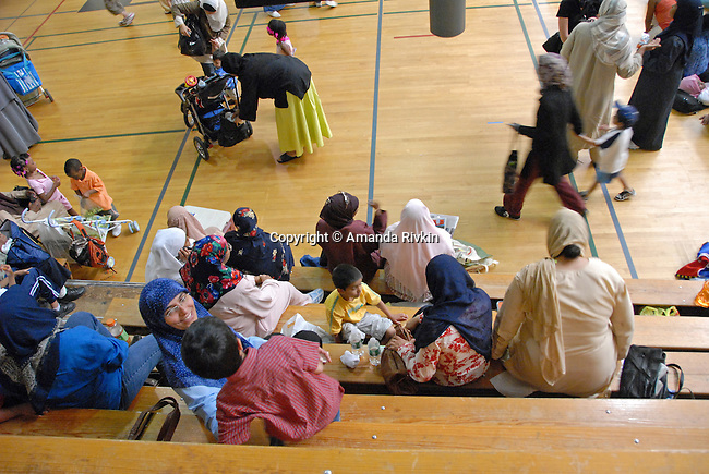"""Families and spectators gather to watch the women's basketball tournament at the Islamic Games in South Brunswick, New Jersey on May 26, 2007.  The event website promised, """"If you can pray in it, you can play in it,""""; over 600 youths from 5 states participated in the event."""