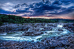 The summer sun sets in glorious colors over Great Falls in Potomac, Maryland.