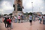 ISTANBUL, TURKEY: People take photos of each other on Istanbul's Taksim Square during the day. Later that evening protestors were cleared from the square by police using tear gas and water cannon.<br /> <br /> Protests that began nearly three weeks ago to try and protect an Istanbul park from redevelopment have spread across Turkey and become an expression of wider discontent with the government of Prime Minister Recep Tayyip Erdogan.<br /> <br /> Photo by Kamaran Najm/Metrography