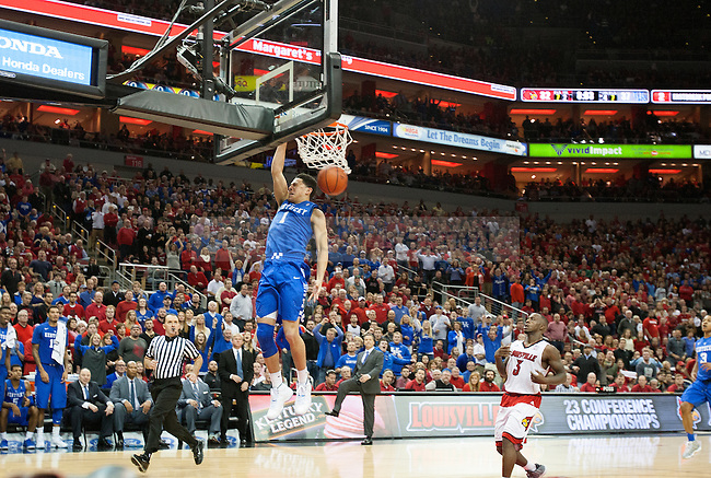 Guard Devin Booker of the Kentucky Wildcats dunks the ball during the game against  the Louisville Cardinals at KFC Yum! Center on Saturday, December 27, 2014 in Louisville `, Ky. Kentucky defeated Louisville 58-50. Photo by Michael Reaves   Staff