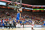 Guard Devin Booker of the Kentucky Wildcats dunks the ball during the game against  the Louisville Cardinals at KFC Yum! Center on Saturday, December 27, 2014 in Louisville `, Ky. Kentucky defeated Louisville 58-50. Photo by Michael Reaves | Staff