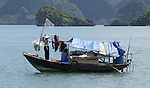 Halong-Vietnam, Ha Long - Viet Nam - 22 July 2005---Houseboat of a smallscale fisher(wo)man, at Halong Bay, a UNESCO World Natural Heritage Site---culture, tourism, nature, transport, housing, people---Photo: Horst Wagner/eup-images