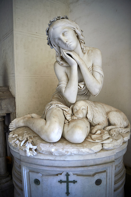 Picture and image of the stone sculpture of a young giral and her dog. The Varni family tomb sculpted by S Varni 1875. Sction D No 25 the monumental tombs of the Staglieno Monumental Cemetery, Genoa, Italy
