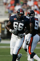 UVa's De'Brickshaw Ferguson playing football for the Virginia Cavaliers playing in Scott Stadium at the University of Virginia in Charlottesville, VA. Photo/Andrew Shurtleff.