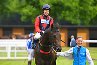Winner of The Dee Wilks Against The Odds(red silks) Confined Novice Stakes (Div 1)Power of Darkness ridden by Hayley Turner and trained by Marcus Tregoning is led into the winners enclosure during Afternoon Racing at Salisbury Racecourse on 12th June 2018