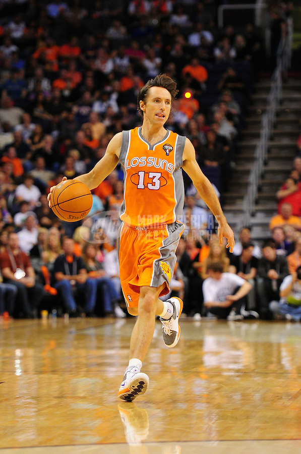 Mar. 25, 2011; Phoenix, AZ, USA; Phoenix Suns guard (13) Steve Nash against the New Orleans Hornets at the US Airways Center. The Hornets defeated the Suns 106-100. Mandatory Credit: Mark J. Rebilas-.