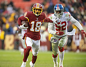 Washington Redskins wide receiver Josh Doctson (18) uses a stiff arm to get away from New York Giants outside linebacker Alec Ogletree (52) in fourth quarter action at FedEx Field in Landover, Maryland on Sunday, December 9, 2018.  The Giants won the game 40 - 16.<br /> Credit: Ron Sachs / CNP<br /> (RESTRICTION: NO New York or New Jersey Newspapers or newspapers within a 75 mile radius of New York City)