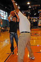 30 September, 2010, Kansas City, Kansas USA.Denny Hamlin tries to get a shot off against the much taller Brad Daugherty at The College Basketball Experience..©2010, F. Peirce Williams, USA.
