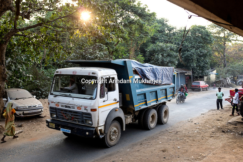A truck brings uranium ore from one of the mines to the Jaduguda mill. There are seven uranium mines in and around Jaduguda and two mills. These are in Jaduguda, Bagjata, Bhatin, Narwapahar, Turamdih, Mohuldih, and Banduhurang. Of these Banduhurang is an open-pit mine, while the rest are underground mines. The two mills are located in Jaduguda and Turamdih.