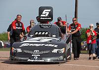 Apr. 28, 2013; Baytown, TX, USA: NHRA crew members for funny car driver Cruz Pedregon during the Spring Nationals at Royal Purple Raceway. Mandatory Credit: Mark J. Rebilas-