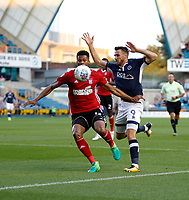 Ipswich Town's Dominic Iorfa is pressured by Millwall's Lee Gregory during the Sky Bet Championship match between Millwall and Ipswich Town at The Den, London, England on 15 August 2017. Photo by Carlton Myrie.