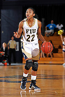 21 January 2012:  FIU guard Jerica Coley (22) handles the ball in the second half as the Florida Atlantic University Owls defeated the FIU Golden Panthers, 50-49, at the U.S. Century Bank Arena in Miami, Florida.