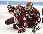 Pat Mullane (BC - 11), Brian Dumoulin (BC - 2) - The Northeastern University Huskies defeated the Boston College Eagles 3-2 on Friday, February 19, 2010, at Matthews Arena in Boston, Massachusetts.