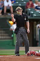 Umpire Thomas Roche makes a call during a game between the Wisconsin Timber Rattlers and Peoria Chiefs on August 21, 2015 at Dozer Park in Peoria, Illinois.  Wisconsin defeated Peoria 2-1.  (Mike Janes/Four Seam Images)
