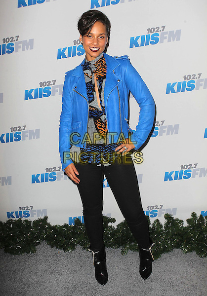 Alicia Keys.KIIS FM 2012 Jingle Ball - Night 2 held at Nokia Theatre L.A. Live, Los Angeles, California, USA..3rd December 2012 .full length blue jacket leather orange print black jeans denim ankle boots hand on hip.CAP/ADM/KB.©Kevan Brooks/AdMedia/Capital Pictures.