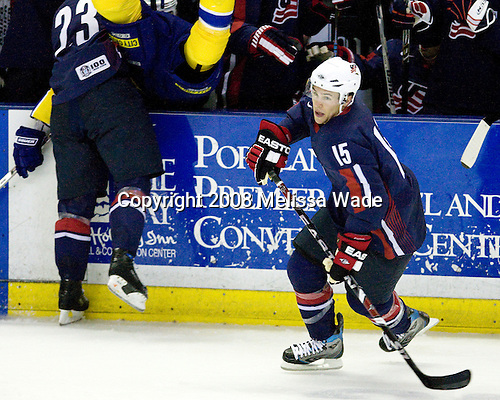 Dustin Brown (USA 23 - Los Angeles Kings/Guelph Storm) puts Alexander Edler (Sweden 23 - Vancouver Canucks) into the US bench - Zach Parise (USA 15 - New Jersey Devils/University of North Dakota) - Team USA defeated Team Sweden 5-1 on Sunday, April 27, 2008, in an exhibition match at the Cumberland County Civic Center in Portland, Maine, prior to the 2008 World Championships.