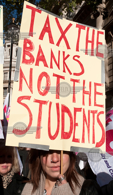 Students and lecturers demonstrate in London against proposed increase in tuition fees.