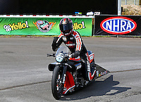 Jul. 20, 2014; Morrison, CO, USA; NHRA pro stock motorcycle rider Andrew Hines celebrates after winning the Mile High Nationals at Bandimere Speedway. Mandatory Credit: Mark J. Rebilas-