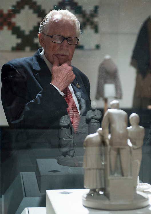 """UNITED STATES - AUGUST 16: Rep. Roscoe Bartlett, R-Md., looks at """"The Slave Auction"""" by John Rogers in the Valley of the Shadows exhibit during his tour of the Washington County Museum of Fine Arts in Hagerstown, Md., as part of the American Association of Museums' 'Invite Congress to Visit Your Museum Week"""" on Thursday, Aug. 16, 2012. (Photo By Bill Clark/CQ Roll Call)"""