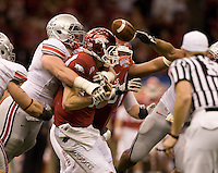 Dexter Larimore of Ohio State sacks Arkansas quarterback Ryan Mallett causes to fumble the ball during the game during 77th Annual Allstate Sugar Bowl Classic at Louisiana Superdome in New Orleans, Louisiana on January 4th, 2011.  Ohio State defeated Arkansas, 31-26.