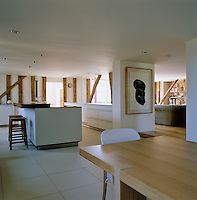 The open-plan kitchen/dining and living area is furnished in contemporary style