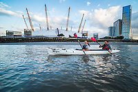 Kayaking on the River Thames past the O2 Arena, Greenwich, London, England